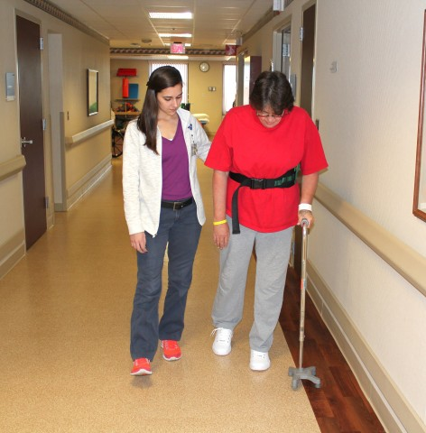 Hutchinson Regional Medical Center staff member walking with patient