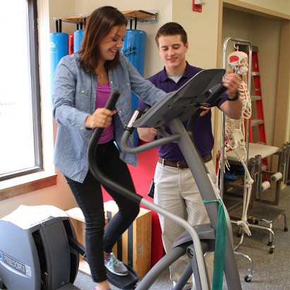 Hutchinson Regional Medical Center staff member working with patient on treadmill